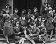 Members of the Women's Army Corps pose in London in 1945. The women's uniforms were made of the same materials as the men's uniforms.