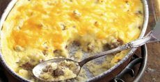 Pull Up A Chair And Enjoy Some Of Granny's Sausage And Cheese Grits Casserole