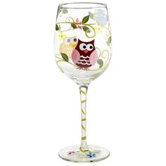 Your next cocktail hour will be a real hoot with this charming glass goblet. Crafted from handblown soda lime glass and painted by hand, it features three curious owls resting on branches, with colorful flowers trailing all the way down the stem for added charm. Just add wine.