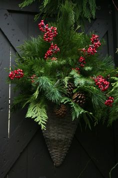 Christmas hanging basket. Green Foam Block. Giant pinecones. Burlap ribbon. Lots of green.