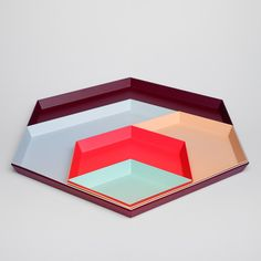 Kaleido // colorful modular tray system by Clara von Zweigbergk. This series of painted steel shapes is designed to nest together.