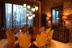 Lovely and unique dining room with ornate velvet chairs and a stone wall, in a Tuscan style home with rustic flair. #interiors #design #interiordesign #decor