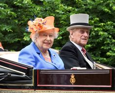 Today the Queen gave the ladies of Royal Ascot a run for their money in an elegant orange  hat and what the Palace described as a 'cobalt blue' coat. Pictured with the Duke of Edinburgh - 16 June 2016.