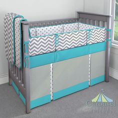 Great pop of Turquoise! Crib bedding in White and Gray Polka Dot, White and Gray Zig Zag, Solid Capri Blue, Solid Cloud Gray. Created using the Nursery Designer® by Carousel Designs where you mix and match from hundreds of fabrics to create your own unique baby bedding.
