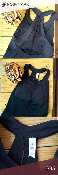 SIZE 6 BLACK LULULEMON TANK *black tank *size 6 *built in bra and pads with small pocket *euc - great for any athletic activity *comes from a smoke-FREE & pet-FREE home lululemon athletica Tops