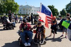 Protesters supporting people with disabilities gather outside the White House in Washington, May 15, 2017.