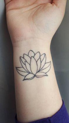 Lotus flower tattoo on Emilys right wrist: Grows...