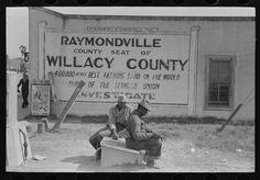 Negroes sitting along railroad tracks, Raymondville, Texas