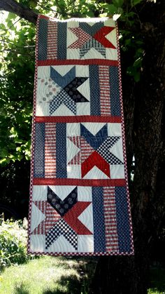 Table runner pattern by Aunt Em's Quilts-- love those stars!