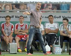 AUGUST 9, 2013 - QUITE the contrast to this decidedly casual ensemble of gingham shirt and jeans, worn of the touchline recently