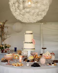 A gorgeous lantern from Ikea draws attention to a dessert table