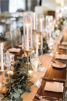 White Pillar Candles in Hurricanes and Gold Details Wedding Decor Ideas Wedding Table Centerpieces, Flower Centerpieces, Centerpiece Ideas, Simple Table Decorations, Wedding Ideas Candles, Classy Wedding Decorations, Rectangle Table Centerpieces, Fall Wedding Table Decor, Vintage Centerpieces