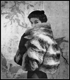 Model in Empress chinchilla jacket with 3/4 sleeves and large soft collar, by Christian Dior, photo by Georges Saad, 1954