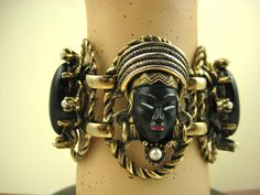 A superb example of an early 1950s Selro Blackamoor princess bracelet. The faces have perfectly complete painted detail intact, with striking golden