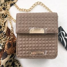 Taupe quilted faux leather Rampage crossbody bag What a chic little bag! Taupe faux leather in a circular quilted pattern. Structured with flap. Gold tone chain crossbody (or shoulder) strap and gold tone hardware. Looks much more expensive than it is. NWT; never worn. Rampage Bags Crossbody Bags