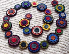 PRiMiTiVE Penny Rug Garland Wool Felt HanDMadE ReUsable banner SWaG  Rustic 36-inches long. $9.50, via Etsy.