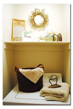 Laundry Room Decor for Small Spaces...instead of 1 shelf, put decor on top of cabinet that holds all the things actually used