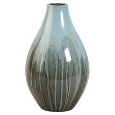 Painted terracotta vase in blue and gray.    Product: VaseConstruction Material: Terracotta and paintColor: Blue and grayFeatures:   Fluid lines and minimalist formWill enhance any setting Dimensions: 11.75 H x 7.25 Diameter