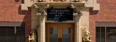 Take a photo with the gold lions outside the historic Merchants National Bank! #Grinnell