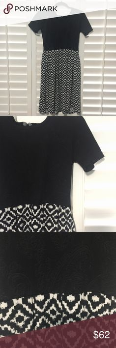 Lularoe Amelia dress small Gorgeous black and white lularoe Amelia dress. The top is embossed with a lovely paisley design and the bottom is geometric. This Amelia flows like no other! So gorgeous. Excellent condition, worn once or twice. Small. LuLaRoe Dresses