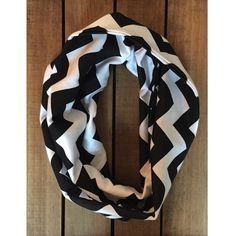 The perfect addition to any toddler's wardrobe! Black Chevron on White Cotton Jersey Blend Knit Fabric Content: 50% Cotton/50% Poly Weight: 7.5 - 8 oz., Light to Medium Weight Stretch: 25%