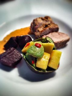 Pork with spicy mango & avocado salad, glazed beets and pepper sauce.