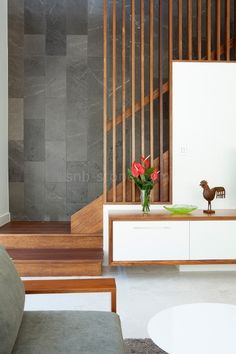 Grey tile cladding, timber and floating credenza.