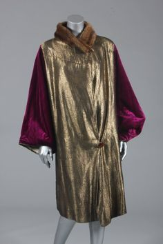 Magenta velvet and gold lame evening coat, late 1920s, with golden diapered panels to the front, wide sleeves, lined in grey silk damask, fur collar