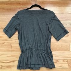 Lululemon Ruffled short sleeve top Size 6 never worn Ruffled top lululemon athletica Tops