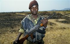 angola war | boy soldier in Angola's civil war Photo: Jack Picone/Alamy