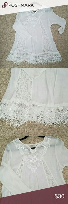 NWOT white sheer cotton v-neck tunic 3/4 sleeves, sheer, v-neck tunic with lace detail and lace trim. Very nice. True to size. Never worn. Tops Tunics