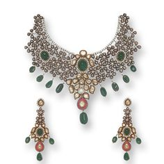 The necklace set is crafted in 18 K and 24 K gold and set with rubies, emeralds, south sea pearl, uncut diamonds, rosecut diamonds and round brilliant diamonds.