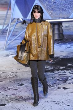 H&M Fall 2016 Paris Fashion Week: Kendall Jenner, Gigi Hadid, and lots of '70s-inspired offerings with big, chunky knits, chevron prints, oversize anoraks, printed flares, wrap coats, and jumpsuits with zip-up fronts. | StyleCaster