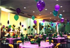mardi gras ball decorations | Colorful helium balloons rising above coordinated table cloths fill ...