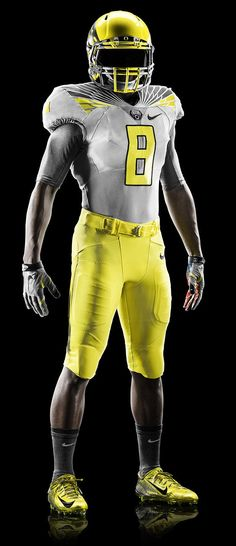 """2014 Oregon Spring Football """"Yellow Strike"""" Uniform. In my opinion the Ducks have the baddest ass uniforms in all of football!"""