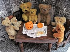 Teddy Bears' Halloween:  My miniature Schuco and Steiff teddy bears have agreed to pose for a Halloween photo, carving their pumpkin. The large scale antique dollhouse table and chairs are just the right size, and featured in last summer's birthday photo, too. The bears date from 1910-1950s; the furniture is early 1900s American; and the backdrop is by Edward Gorey, from his Dracula Toy Theatre.