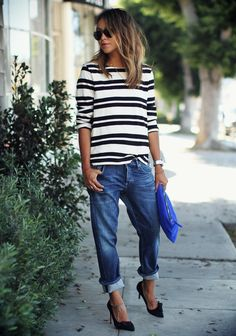 Julie Sarinana is wearing a crop boyfriend jeans from Citizens of Humanity, striped top from APC, clutch from ThePertext and shoes from Isabel Marant