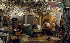 Jeff Wall -- Artist & photographer. Not sure about title for this, just very disappointed the whole thing is staged, from light bulbs to hanging clothes. That said, there must be people who live in such whimsical abodes of self-creation?