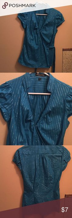Express blue wrap around dress shirt small Worn maybe once or twice, please ask all questions prior to purchasing. Check my other listings to bundle. I'm always open to reasonable offers, thanks! Express Tops Button Down Shirts