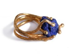 Ring of Omnipresence collection by Pink Moss Jewelry,  designer- Irina Moise,Romania. Materials: silver azurite crystal ring, gold-plated.