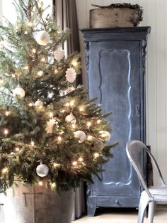 I like the idea of doing a mini real potted Christmas tree instead of a big one. Seems simple, yet beautiful #simplicity