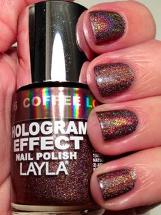 Layla - Coffee Love. Three coats, no topcoat.  This color is just gorgeous. I absolutely LOVE brown nail polish and finding a brown holo was exciting. The excitement went away, though, upon application. The formula was horrible. It was thin and runny and nearly impossible to apply without getting really bad bald spots, even with careful, light brush strokes. And actually, the third coat was just one brush down the middle to cover the exposed nail that was till left after two coats.