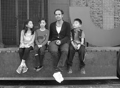 "Tino Sehgal: This Progress. Beijing 2013: ""Tino Sehgal sits on the gate of UCCA with children, who visit his exhibition that continues in Beijing through Nov 17. Zou Hong / China Daily"""