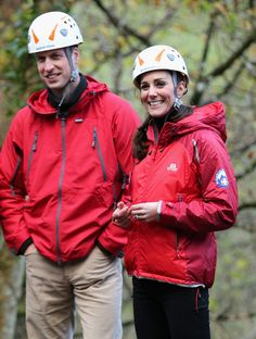 Prince William, Duke of Cambridge and Catherine, Duchess of Cambridge watch children on a zip-wire as they visit the Towers Residential Outdoor Education Centre on November 20, 2015 in Capel Curig, United Kingdom.