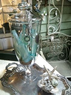 Blossoms Vintage Chic love the vintage blue bottles in the apothocary jar