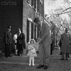 Newly-elected President John F. Kennedy walks with his daughter Caroline to church on her third birthday, 27 November 1960 © Bettmann/CORBIS