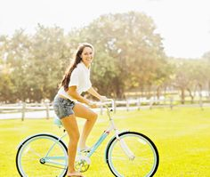image #009yda15 Young woman riding bicycle in park #photo #image #femme #velo