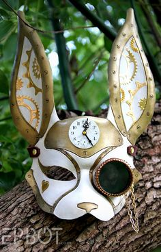 DIY Alice in Wonderland Steampunk White Rabbit Mask Tutorial from EPBOT here.   This leather mask and giant pocket watch (vintage wall clock) were obviously a labor of love and patience.