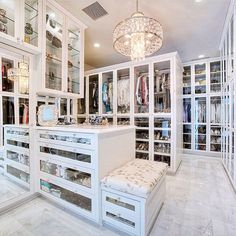 I'd have such fun organizing my fashion finds in this beautiful spacious closed!