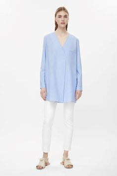 COS image 1 of Long oversized v-neck top in Sky Blue